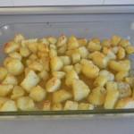 Una vez doradas, sacamos las patatas al romero del horno