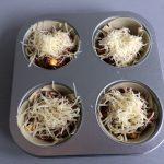 Añadimos queso emmental rallado